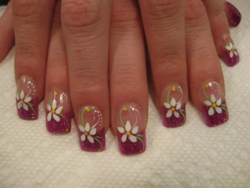 Sparkling pink tip with white petal daisy and yellow dot center with green/white/sparkly swirls, white/yellow dots.