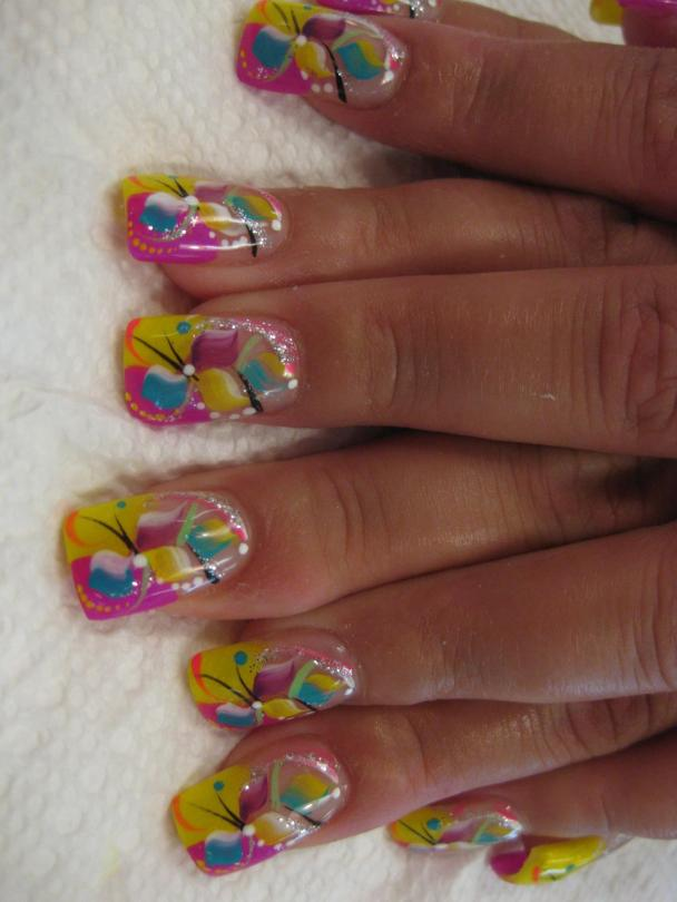 Half curved bright yellow/half curved bright pink tip with blue/white/yellow/purple petals, black/orange/green/yellow/blue/sparkly swirls, white/blue/yellow dots.