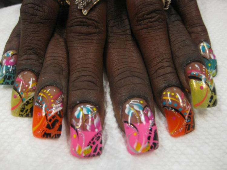 Bright (choice of color) tip with curved cheetah print on half, yellow/pink/blue/white lilies, multi-colored swirls and dots.