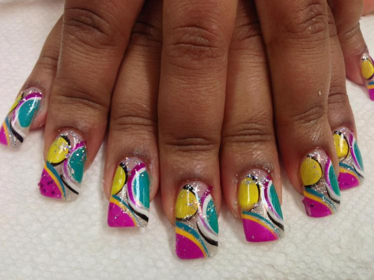 Bright pink tip with bright yellow and bright aqua on sides, yellow/aqua/black/white/bright pink swirls, sparkles.