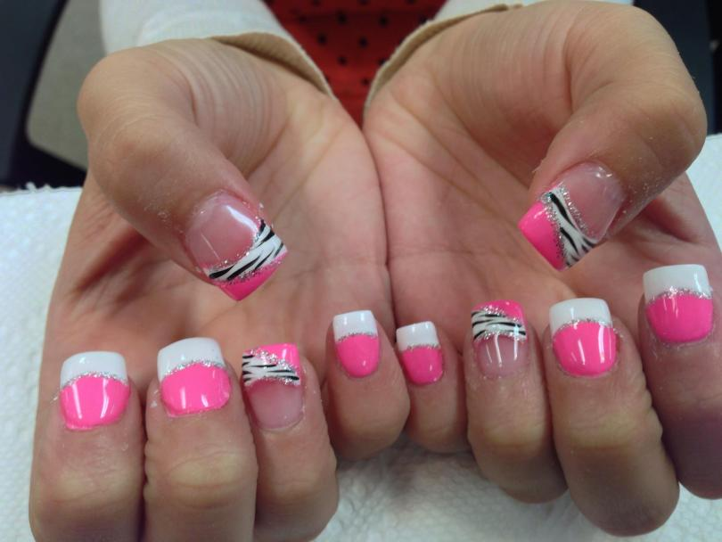 Angled bright pink tip under black/white zebra band with sparkly swirls.