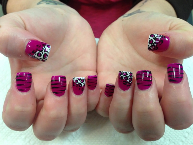 Bright pink full nail with black tiger stripes OR angled opaque white tip, bright pink nail with pink/black leopard spots.