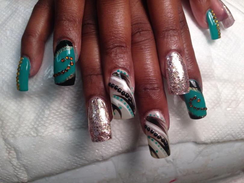 Subdued pink/textured nail, OR angled short black/long turquoise nail w/topaz glue-ons swirled OR translucent white tip w/diagonal black/white/blue-dotted/black-dotted glue-ons.