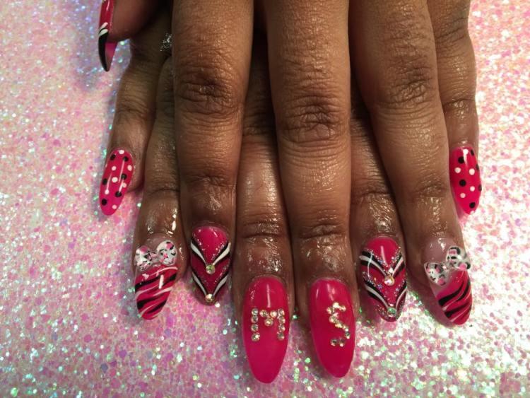 Bright pink tip w/black/white tiger stripes, Hello Kitty bow OR Bright pink nail w/diamond glue-ons or black/white dots OR sparkly/white/black swirls.