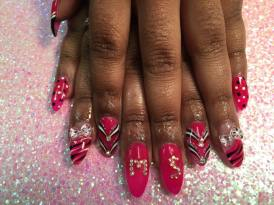 Bright pink tip w/black/white tiger stripes, Hello Kitty bow OR Bright pink nail w/diamond glue-ons or black/white dots OR sparkly/white/black swirls.