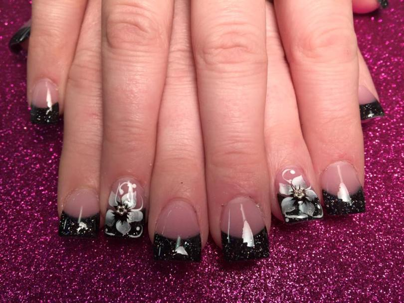 Sparkly black tip with large white/silver lily, diamond glue-on center, white swirls, white dots.