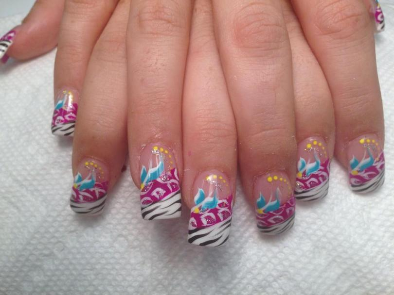 Angled opaque brilliant white tip with black zebra lines under angled bright pink band w/sparkly/white leopard spots, sky blue/white swishes, sparkles, yellow dots.