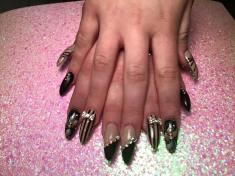 Choice: Angled black tip, translucent nail, diagonal diamond glue-ons OR translucent nail, vertical black stripes, diamond/silver bowtie, OR black onyx nail, silver stargazer lily, diamond glue-on.