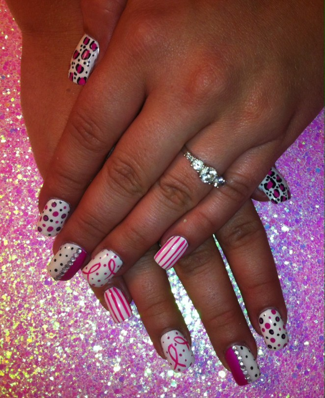 Opaque brilliant white nail (or half Bright pink) with varying designs (pink/black dots, pink swirls, vertical pink lines, pink leopard spots).