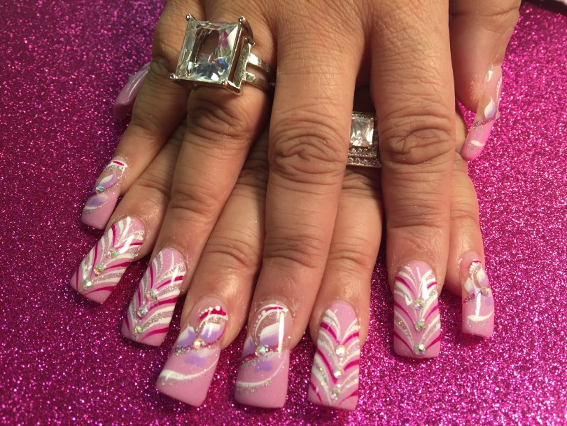 Choice: Light pink nail or tip with various white/bright pink/sparkly swirl designs, lavender/white swishes, diamond glue-ons, sparkles, white dots.