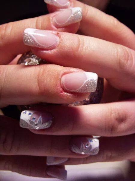 Choice: Half-sparkly silver/half-opaque white tip curved to cuticle, topped w/flesh colored nail, w/optional sparkly/silver stargazer on side, diamond glue-on.