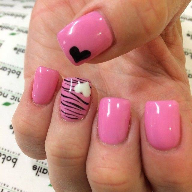 Shiny Light pink nail with optional black or white heart in corner and black tiger stripes.