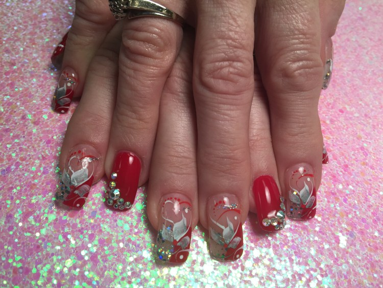 Choice: Shiny brilliant red nail w/diamond glue-ons, OR half-curved brilliant red/half-curved sparkly translucent white tip w/silver/white swishes, mirrored glue-ons, white/red/sparkly swirls, red/white dots.