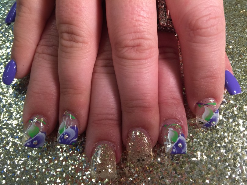 Choice: Translucent white nail with gold sparkles OR Angled half-curved lavender/half-curved translucent gold sparkled tip w/green/white swishes, white/green swirls, white dots, sparkles.
