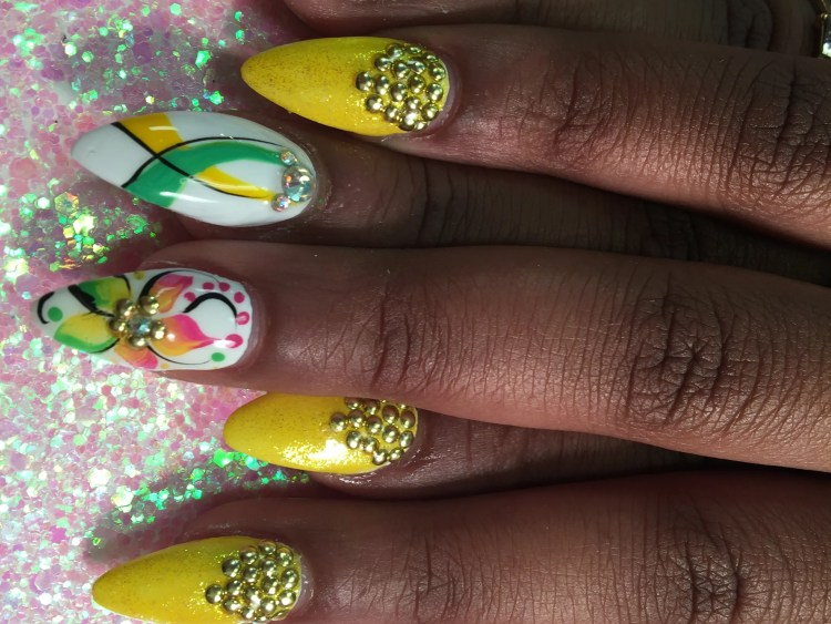 Choice: Point-tipped shiny sparkly banana yellow nail with gold bead glue-ons at cuticle OR opaque brilliant white nail w/pink/orange/green/yellow stargazer lily, gold glue-on center, black swirls, pink/green dots OR green/yellow/black swirl design w/diamond glue-ons.