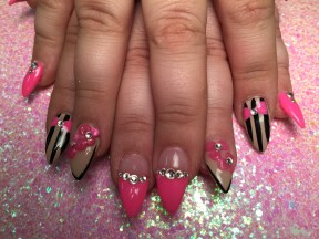 Choice: Shiny light pink tip/flesh nail/diamond glue-ons, OR translucent nail, shiny black vertical lines, pink bowtie, diamond glue-on, OR translucent nail, thin black-lined tip, raised pink flower glue-ons, OR Shiny bright pink nail with diamond glue-ons.