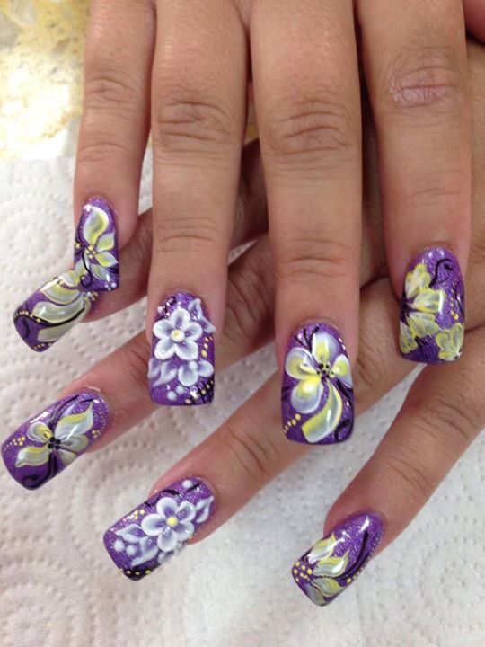 Bright sparkly purple nail w/crystalline white flower and petals, black swirls, white/yellow dots, sparkles, OR white/yellow flower.