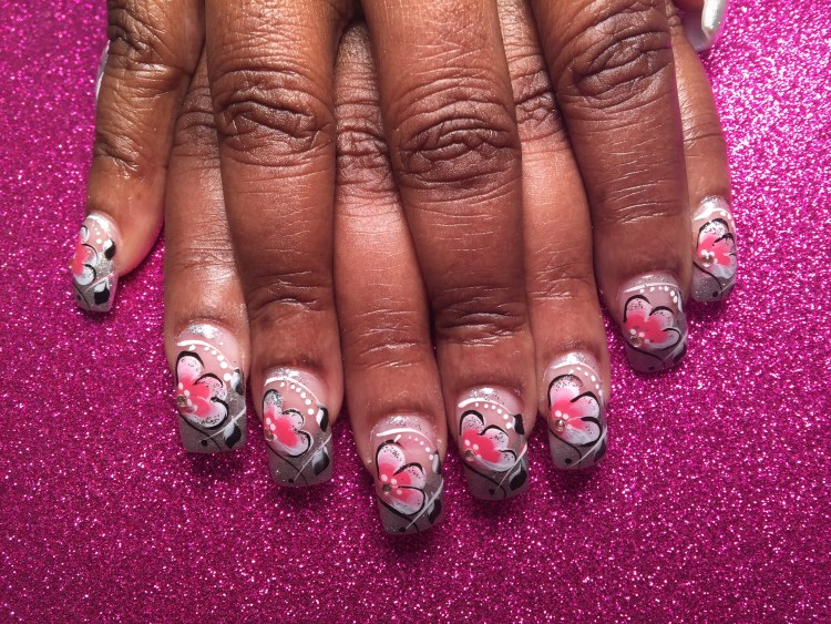 Sparkling silver starlight tip, translucent color on nail, bright pink/light pink/white stargazer lily tipped w/black, white/black swirls, white dots, sparkles.