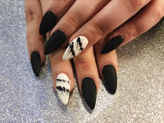 Black stiletto matte gel top with design on ring fingers