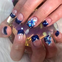Blue cateye gel with cute flower nail art