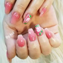 Dipping powder ombre on her natural nails, with hand painted rose nail art