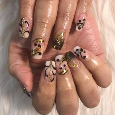 SNS dip powder ombre on natural nails with black & gold design to match her dress