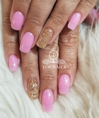 Lovely pink with gold glitter accent nails. SNS dip powder on a long healthy natural nails.