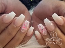 Dipping ombre nails with flower nail art.