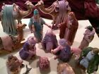 A large Ceramic 15 piece Hand painted and adorned with jewels Nativity set