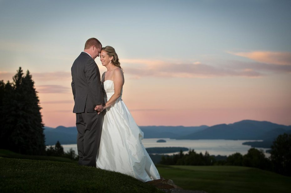 Bride & Groom on Golf Course overlooking Lake George and the Adirondack Mountains at Top of the World Golf Resort