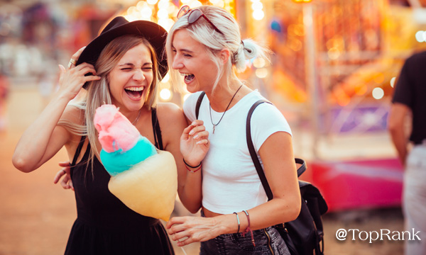 Two women with cotton candy image.