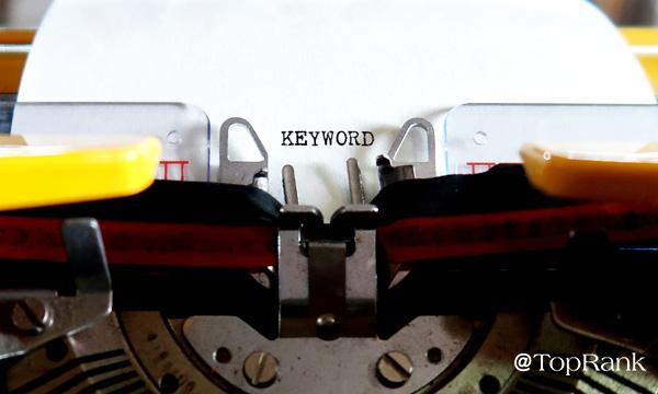 Typewriter with keyword on sheet of paper image.