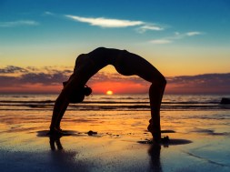 woman exercising at the beach sunrise
