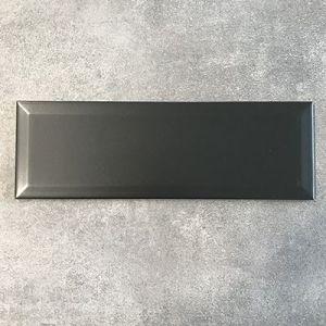 Wandtegels in mat zwart formaat 10x30cm.