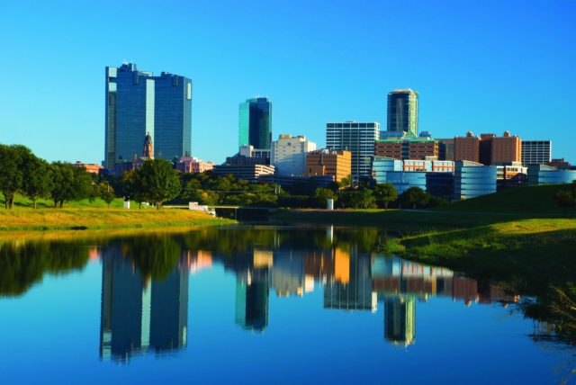 Fort Worth skyline with the Trinity River in the foreground.