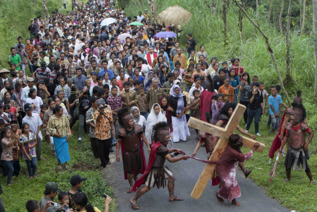 Vilagers take part in an Easter Passion Play re-enacting the crucifixion of Jesus Christ on Good Friday at Gantang Village near Magelang, in the province of Central Java