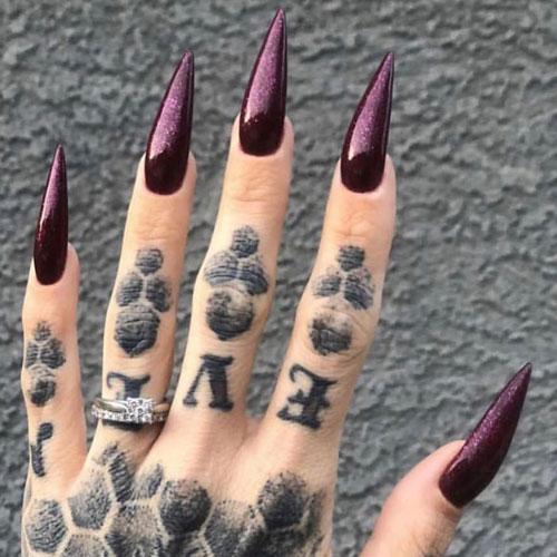 Fierce Purple Stiletto Nails