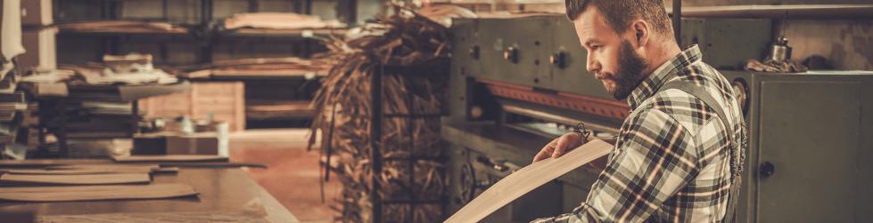 Man inspecting wood veneer sheet