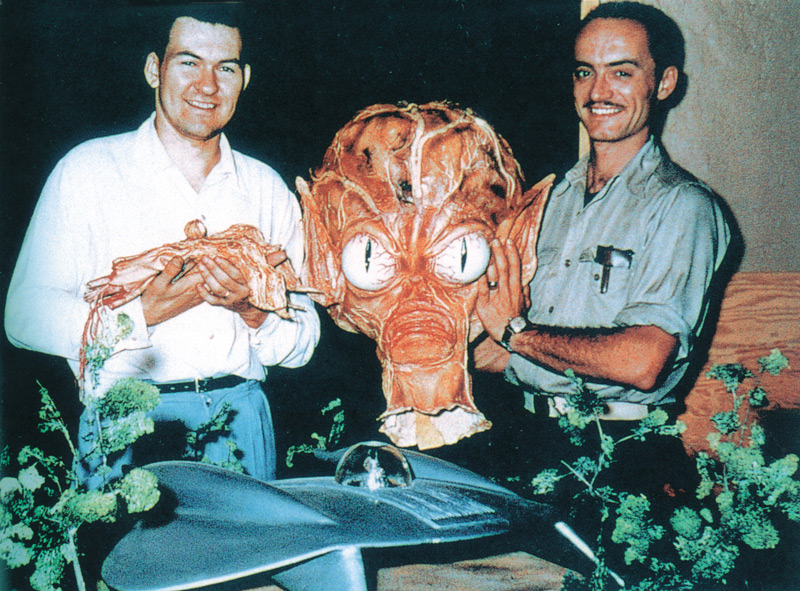 1957, Bob Burns (left) and Paul Blaisdell with parts of a Saucer Man costume and the main flying saucer prop carved by Blaisdell out of white pine for the motion picture Invasion of the Saucer Men, AIP, 1957. Click to enlarge.