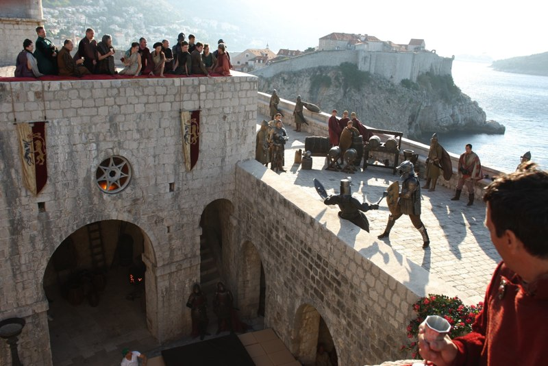 We, Joffrey and half the city watch the Name Day tournament in Game of Thrones.