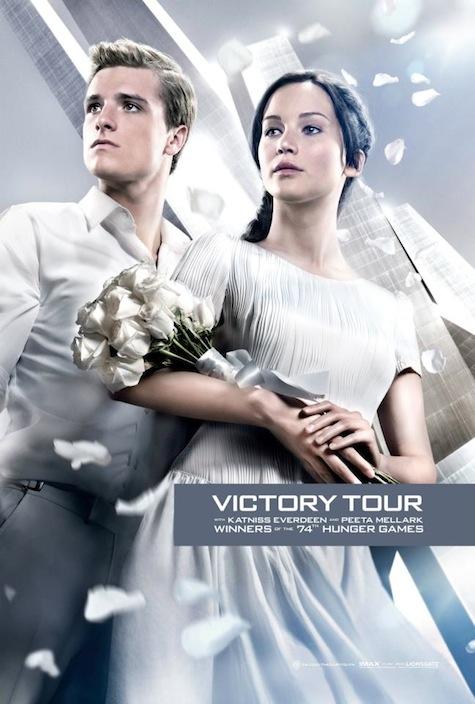 Catching Fire Victory Tour propaganda posters Katniss Everdeen Peeta Mellark engagement Jennifer Lawrence Josh Hutcherson