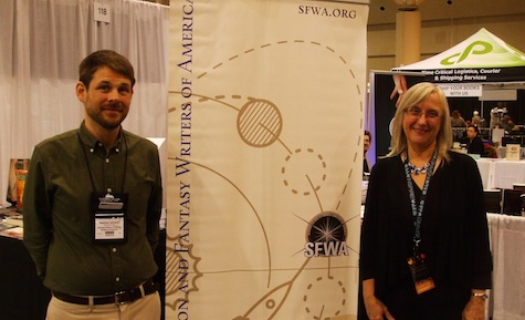 Matthew Johnson and Julie Czerneda at the SFWA booth