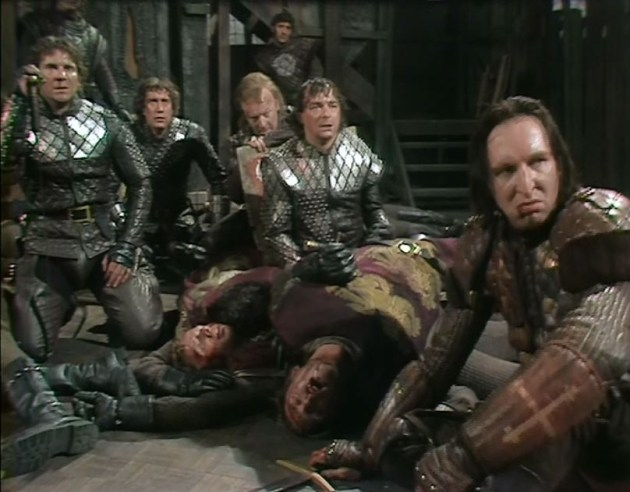 Mark Wing-Davey as the wild and battle-stained Warwick (right) with the three sons of York, after an exhausting battle, from the Jane Howell production, BBC Shakespeare Collection.