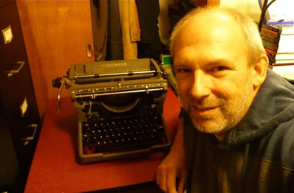 Frederic S. Durbin with his Underwood standard (1951), a present from his wife last Christmas--the first machine in the collection.