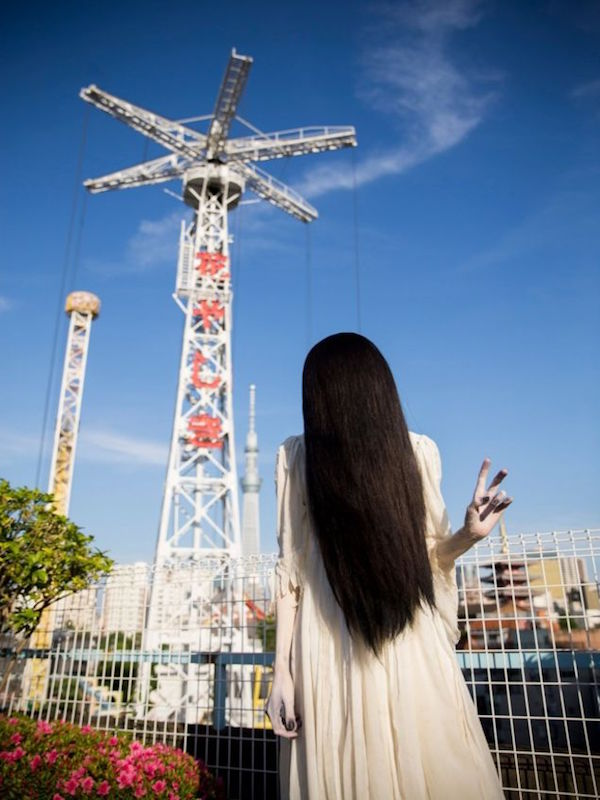 Sadako flashes a peace sign