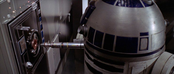 R2-D2 jacking into computer