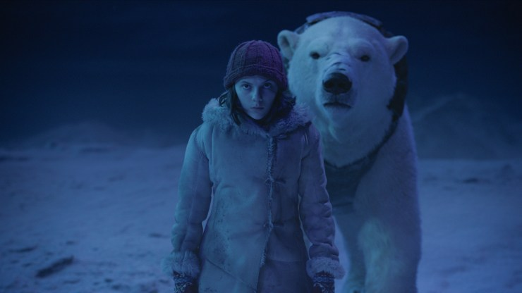 Lyra (Dafne Keen) and Iorek in His Dark Materials