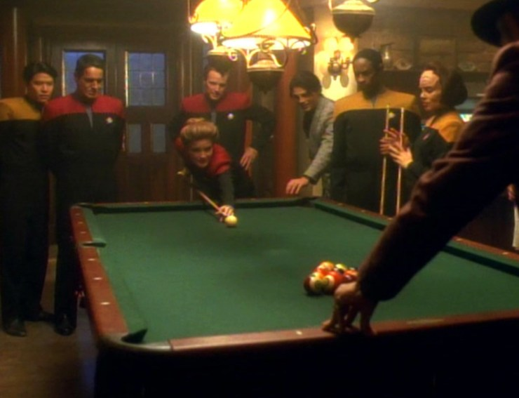 Captain Janeway plays pool with the crew on Star Trek: Voyager