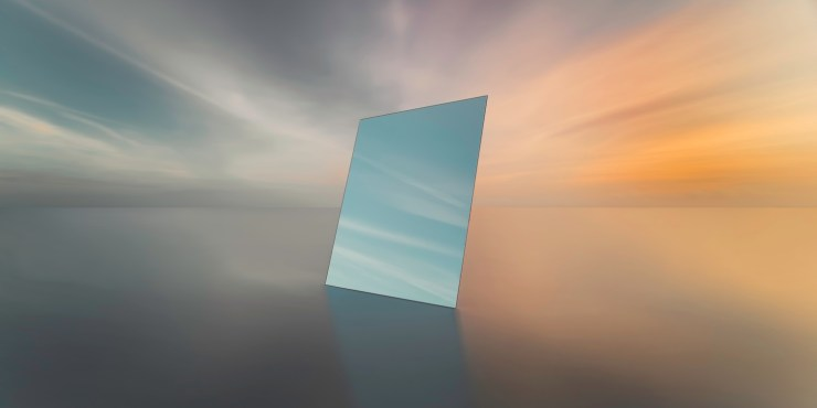 mirror reflecting the sky at sunset