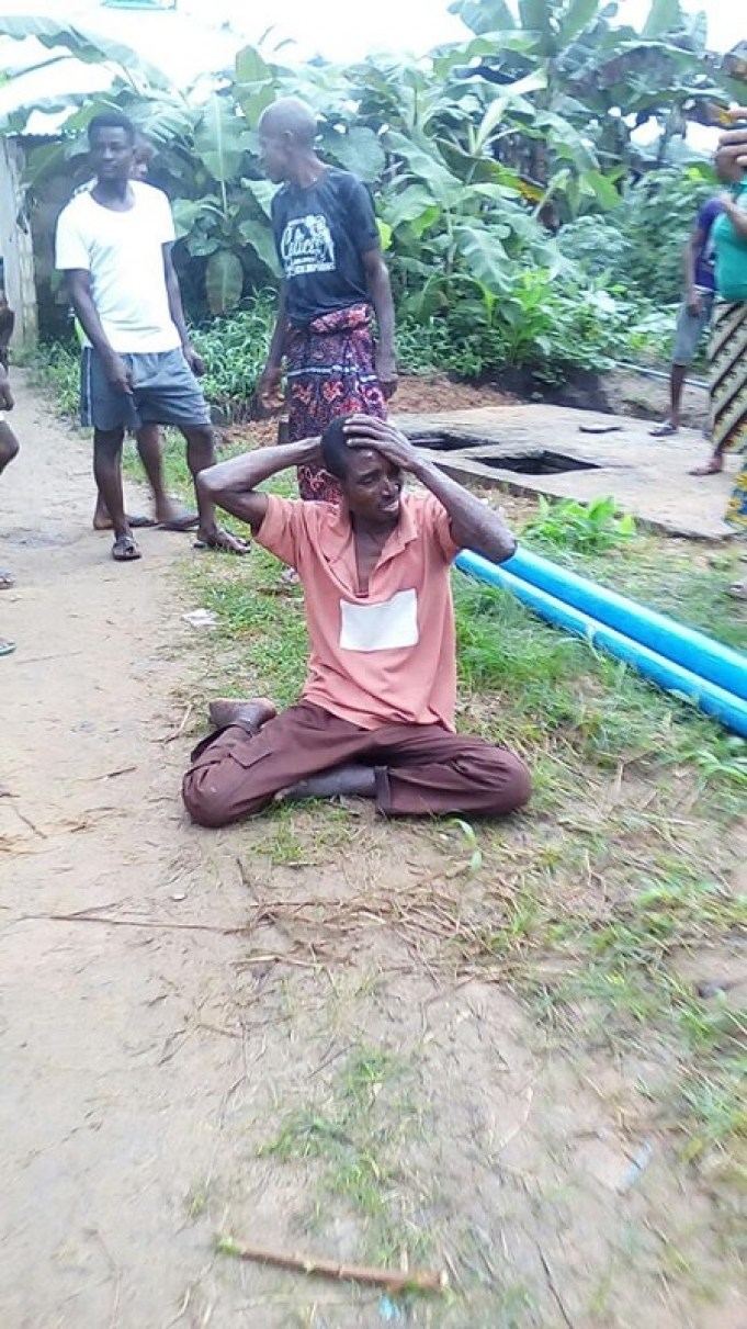 SHOCKING PHOTOS OF HOW A THIEF GLUED TO PILLAR WHILE TRYING TO STEAL BUILDING MATERIALS IN AKWA IBOM STATE (PHOTOS)